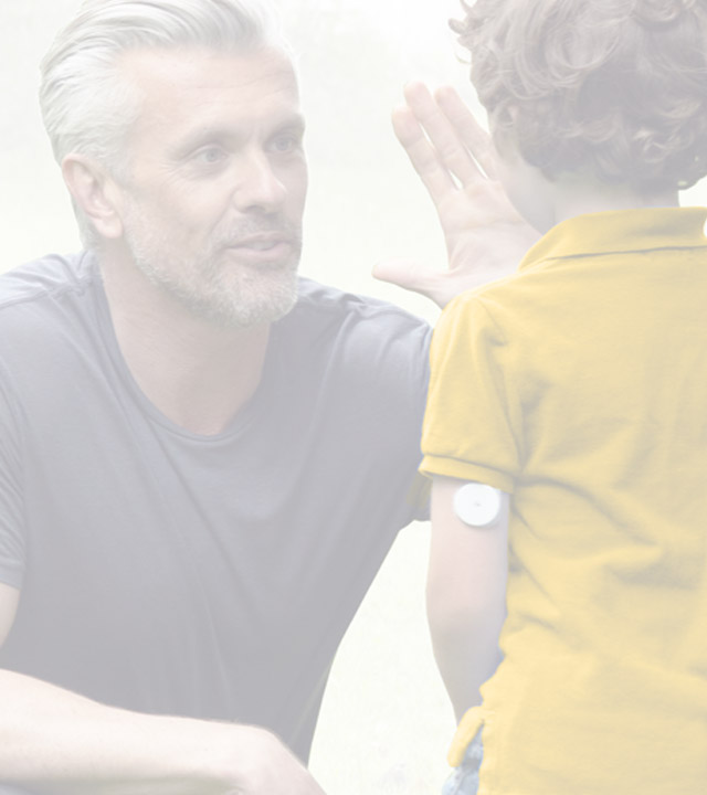 Man and boy wearing FreeStyle Libre Sensor