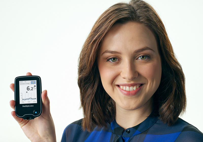 Woman holding FreeStyle Libre Reader